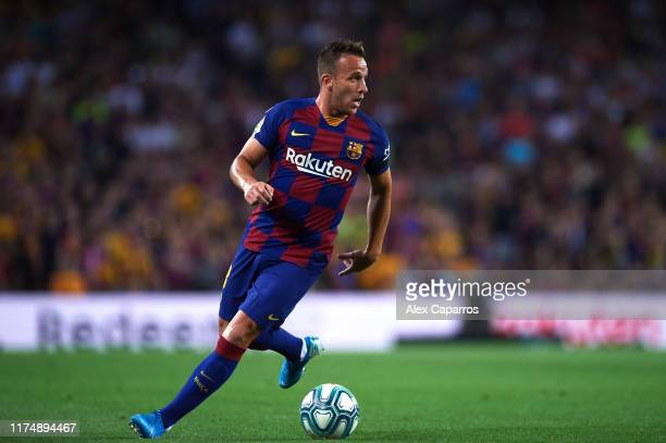 Arthur Melo of FC Barcelona conducts the ball during the La Liga match between FC Barcelona and Valencia CF at Camp Nou on September 14, 2019 in...