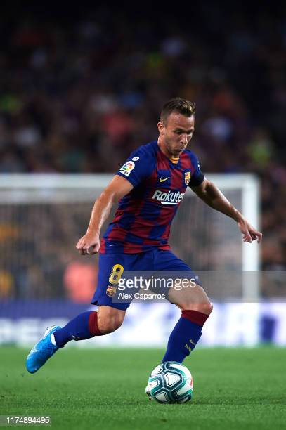 Arthur Melo of FC Barcelona conducts the ball during the La Liga match between FC Barcelona and Valencia CF at Camp Nou on September 14 2019 in...