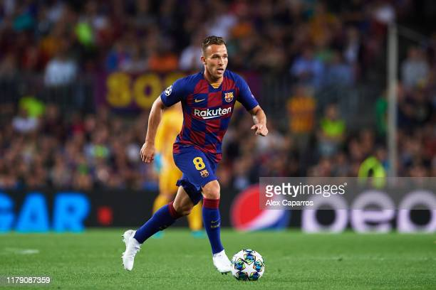 Arthur Melo of FC Barcelona conducts the ball during the UEFA Champions League group F match between FC Barcelona and Inter at Camp Nou on October 02...