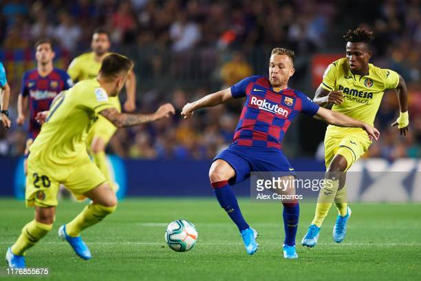 Arthur Melo of FC Barcelona controls the ball under pressure from Zambo Anguissa of Villarreal CF during the Liga match between FC Barcelona and...