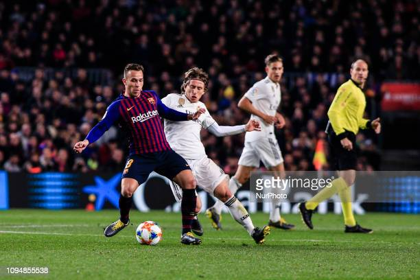 Arthur Melo of FC Barcelona defended by 10 Modric of Real Madrid during the semi-final first leg of Spanish King Cup / Copa del Rey football match...