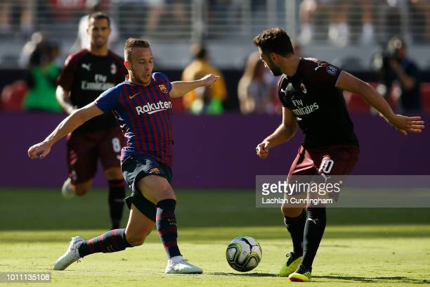 Arthur Melo of FC Barcelona intercepts a pass intended for Hakan Calhanoglu of AC Milanduring the International Champions Cup match at Levi's Stadium...