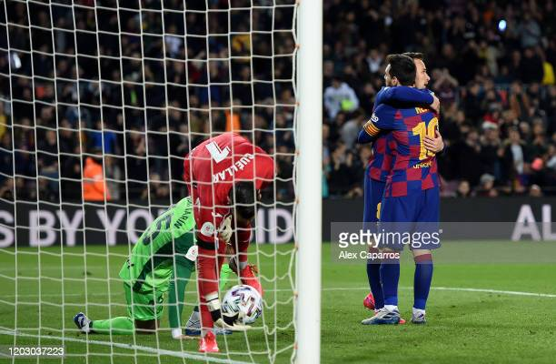 Arthur Melo of FC Barcelona is congratulated by team mate Lional Messi after scoring the fourth goal during the Copa del Rey Round of 16 match...