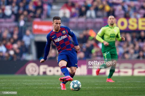 Arthur Melo of FC Barcelona plays the ball during the La Liga match between FC Barcelona and SD Eibar SAD at Camp Nou on February 22, 2020 in...