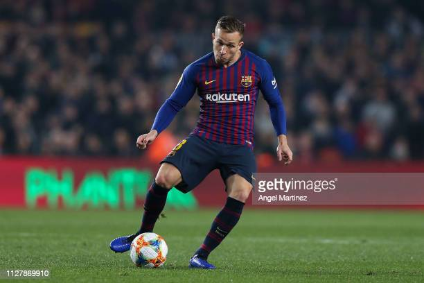 Arthur Melo of FC Barcelona runs with the ball during the Copa del Semi Final first leg match between Barcelona and Real Madrid at Nou Camp on...