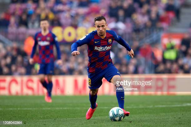 Arthur Melo of FC Barcelona runs with the ball during the La Liga match between FC Barcelona and SD Eibar SAD at Camp Nou on February 22, 2020 in...