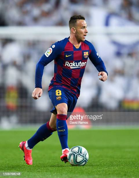 Arthur Melo of FC Barcelona runs with the ball during the Liga match between Real Madrid CF and FC Barcelona at Estadio Santiago Bernabeu on March 01...