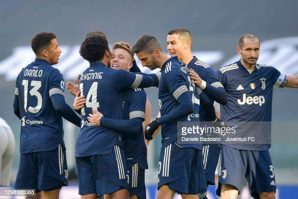 Arthur Melo of Juventus celebrates with teammates after scoring his team's first goal the Serie A match between Juventus and Bologna FC at Allianz...