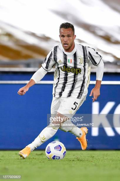 Arthur Melo of Juventus kicks the ball during the Serie A match between AS Roma and Juventus at Stadio Olimpico on September 27, 2020 in Rome, Italy.