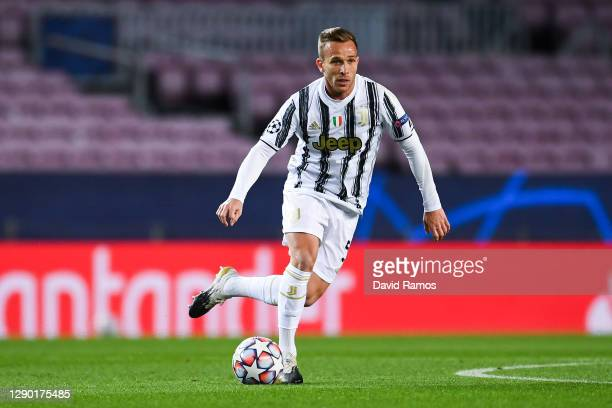 Arthur Melo of Juventus runs with the ball during the UEFA Champions League Group G stage match between FC Barcelona and Juventus at Camp Nou on...