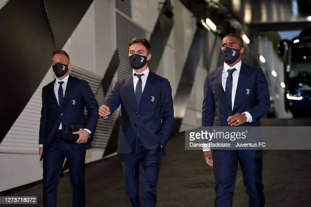Arthur Melo Paulo Dybala and Douglas Costa of Juventus arrive at the stadium prior to the Serie A match between Juventus and UC Sampdoria at on...