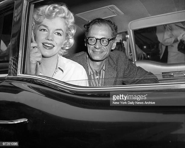 Arthur Miller the playwright gazes' adoringly at his wife Marilyn Monroe as they drive away from Lenox HIll Hospital The dazzling film star was...