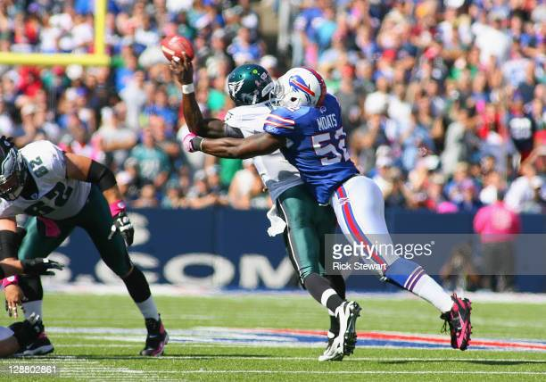 Arthur Moats of the Buffalo Bills hits Michael Vick of the Philadelphia Eagles causing Vick to throw an interception in the first half at Ralph...