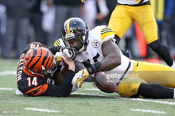 Arthur Moats of the Pittsburgh Steelers beats Andy Dalton of the Cincinnati Bengals to a loose ball during the fourth quarter at Paul Brown Stadium...