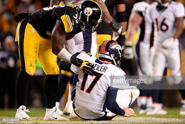 Arthur Moats of the Pittsburgh Steelers helps Brock Osweiler of the Denver Broncos to his feet after knocking him down during the second half of the...