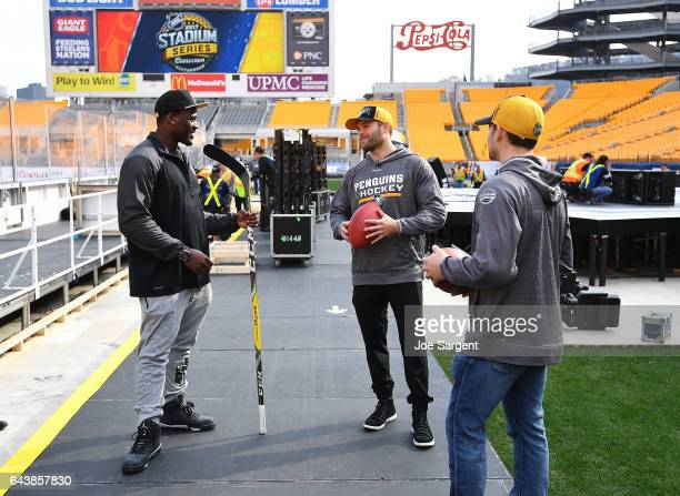 Arthur Moats of the Pittsburgh Steelers talks with Bryan Rust and Conor Sheary of the Pittsburgh Penguins during media availability for the 2017...