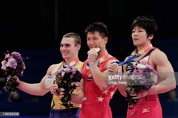Arthur Nabarrete Zanetti of Brazil Chen Yibing of China and Koji Yamamuro of Japan stand on the podium after the Men's apparatus finals during the...