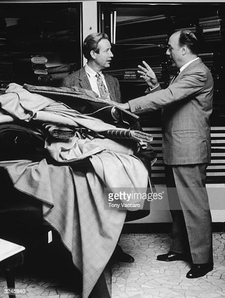 Arthur O'Connell talks with Gaetano Savini one of the creators of the menswear store Brioni inside his store Rome