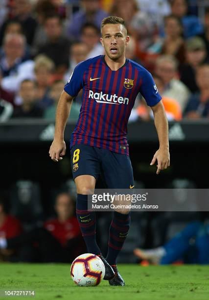 Arthur of Barcelona runs with the ball during the La Liga match between Valencia CF and FC Barcelona at Estadio Mestalla on October 7 2018 in...