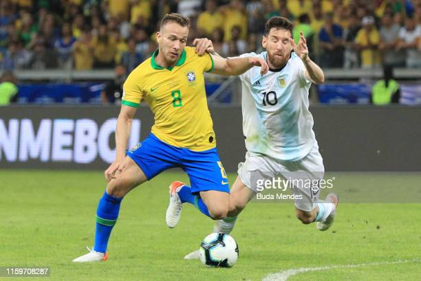 Arthur of Brazil fights for the ball with Lionel Messi of Argentina during the Copa America Brazil 2019 Semi Final match between Brazil and Argentina...