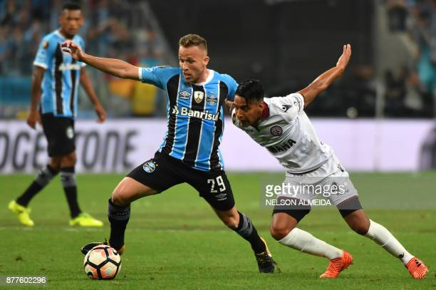 Arthur of Brazils Gremio vies for the ball with Jose Gomez of Argentina's Lanus during their 2017 Copa Libertadores final first leg match held at...