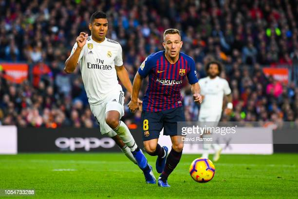 Arthur of FC Barcelona competes for the ball with Carlos Enrique Casimiro of Real Madrid CF during the La Liga match between FC Barcelona and Real...