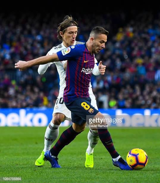 Arthur of FC Barcelona competes for the ball with Luka Modric of Real Madrid CF during the La Liga match between FC Barcelona and Real Madrid CF at...