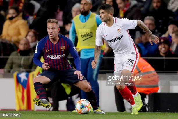 Arthur of FC Barcelona Ever Banega of Sevilla FC during the Spanish Copa del Rey match between FC Barcelona v Sevilla at the Camp Nou on January 30...