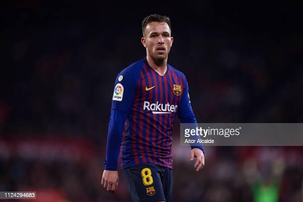 Arthur of FC Barcelona looks on during the Copa del Quarter Final match between Sevilla FC and FC Barcelona at Estadio Ramon Sanchez Pizjuan on...