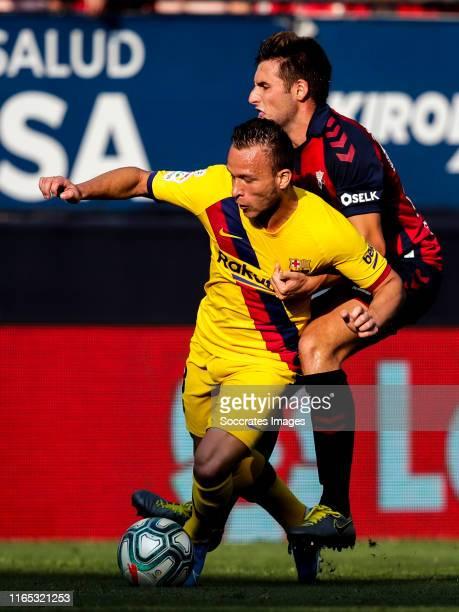Arthur of FC Barcelona Nacho Vidal of CA Osasuna during the La Liga Santander match between Osasuna v FC Barcelona at the Estadio El Sadar on August...