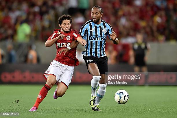 Arthur of Flamengo struggles for the ball with Ze Roberto of Gremio during a match between Flamengo and Gremio as part of Brasileirao Series A 2014...