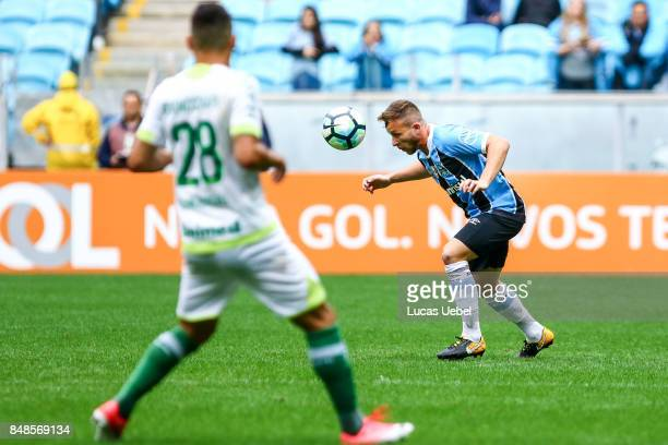 Arthur of Gremio battles for the ball against Alan Ruschel of Chapecoense during the match Gremio v Chapecoense as part of Brasileirao Series A 2017...