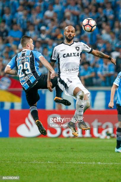 Arthur of Gremio battles for the ball against Bruno Silva of Botafogo during the match between Gremio and Botafogo as part of Copa Bridgestone...