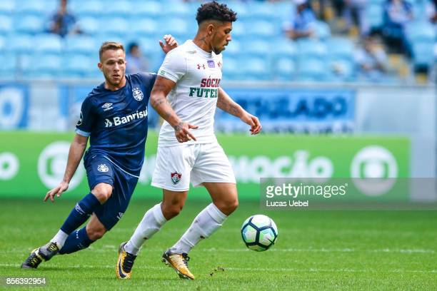 Arthur of Gremio battles for the ball against Douglas of Fluminense during the match Gremio v Fluminense as part of Brasileirao Series A 2017 at...