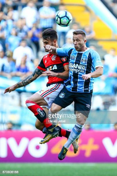 Arthur of Gremio battles for the ball against Felipe Vizeu of Flamengo during the match Gremio v Flamengo as part of Brasileirao Series A 2017 at...