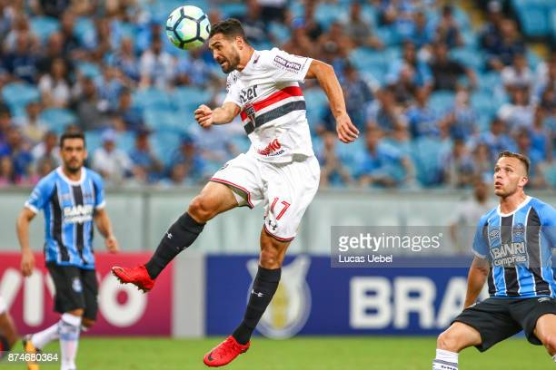 Arthur of Gremio battles for the ball against Gilberto of Sao Paulo during the match between Gremio and Sao Paulo as part of the Brasileirao Series A...