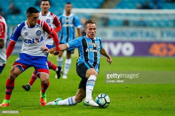 Arthur of Gremio battles for the ball against Juninho of Bahia during the match between Gremio and Bahia as part of Brasileirao Series A 2017 at...