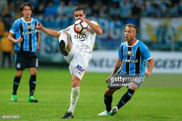Arthur of Gremio battles for the ball against Marcelo Palau of Guarani during the match Gremio v Guarani as part of Copa Bridgestone Libertadores...