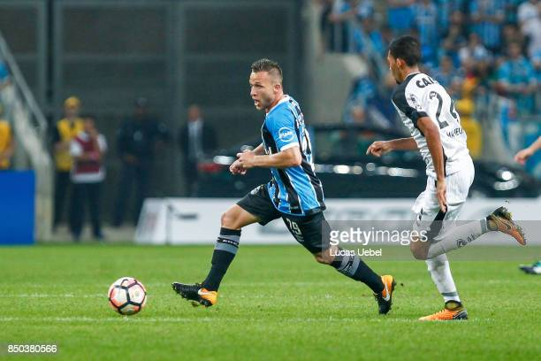 Arthur of Gremio battles for the ball against Matheus Fernandes of Botafogo during the match between Gremio and Botafogo as part of Copa Bridgestone...