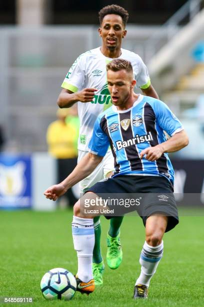 Arthur of Gremio battles for the ball against Moises Ribeiro of Chapecoense during the match Gremio v Chapecoense as part of Brasileirao Series A...