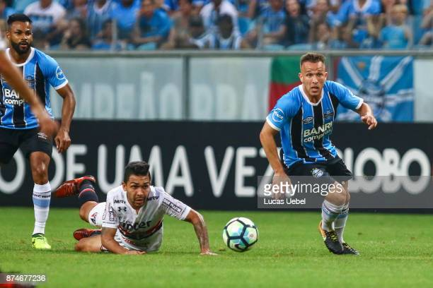 Arthur of Gremio battles for the ball against Petros of Sao Paulo during the match between Gremio and Sao Paulo as part of the Brasileirao Series A...
