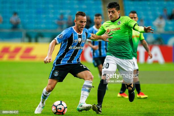 Arthur of Gremio battles for the ball against Ricardo Clarke of Zamora during the match Gremio v Zamora as part of Copa Bridgestone Libertadores 2017...