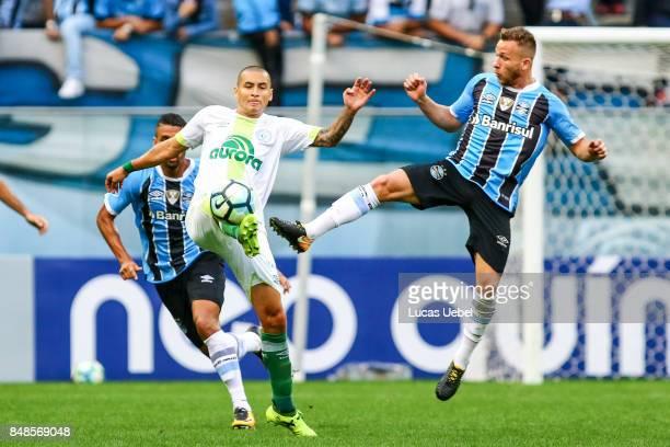 Arthur of Gremio battles for the ball against Wellington Paulista of Chapecoense during the match Gremio v Chapecoense as part of Brasileirao Series...