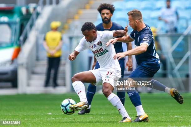 Arthur of Gremio battles for the ball against Wendel of Fluminense during the match Gremio v Fluminense as part of Brasileirao Series A 2017 at Arena...
