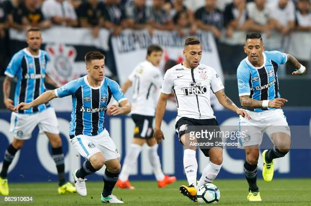 Arthur of Gremio Maycon of Corinthians and Lucas Barrios of Gremio in action during the match between Corinthians v Gremio for the Brasileirao Series...