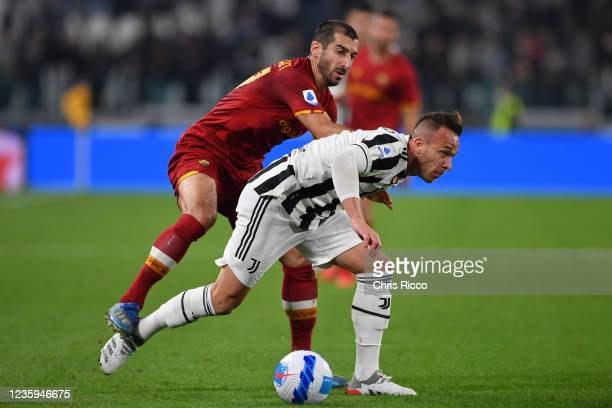 Arthur of Juventus challenged by Henrikh Mkhitaryan of AS Roma during the Serie A match between Juventus and AS Roma at Allianz Stadium on October...