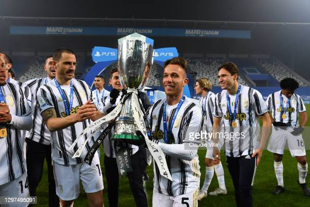 Arthur of Juventus poses for a photo with the PS5 Supercup following their side's victory in the Italian PS5 Supercup match between Juventus and SSC...