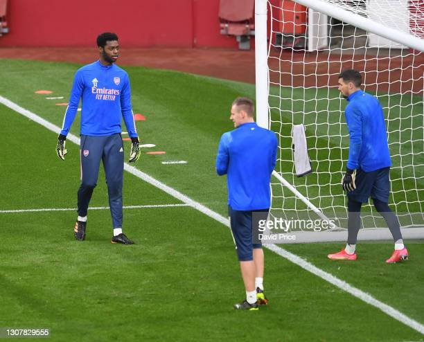 Arthur Okonkwo of Arsenal warms up before the UEFA Europa League Round of 16 Second Leg match between Arsenal and Olympiacos at Emirates Stadium on...