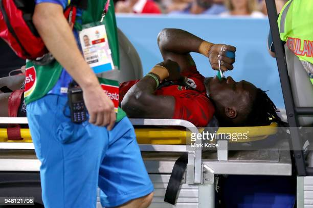 Arthur Owira of Kenya leaves the field on a medicab during the Rugby Sevens match between Kenya and Zambia on day 10 of the Gold Coast 2018...