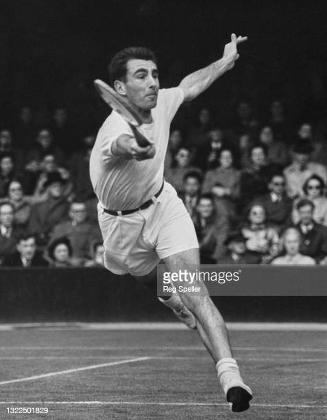 """Arthur """"Paddy"""" Roberts of Great Britain reaches to make a running forehand return against Bernard Destremau of France during their Men's Singles..."""